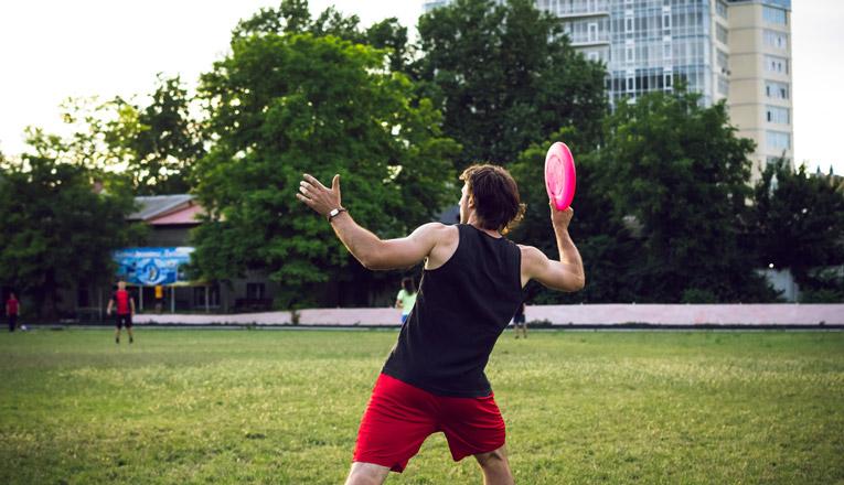 man throw pink disc